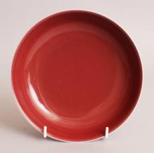 A GOOD QUALITY CHINESE COPPER RED PORCELAIN SAUCER DISH, the base with a six-character Yongzheng mark, 7.1in diameter.