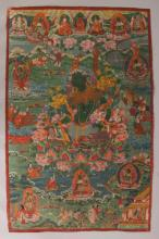 A GOOD QUALITY 19TH CENTURY TIBETAN THANGKA PAINTING ON CLOTH, painted to its centre with the Green Tara seated on a foliate lotus plinth, 29in x 19.5in.