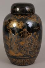 AN EARLY 20TH CENTURY CHINESE MIRROR BLACK PORCELAIN JAR & COVER, the sides painted in gilding with the Fu Lu Shou deities in a garden setting, the base with an early 'CHINA' mark in underglaze-blue, 7.75in high overall.