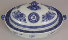 AN 18TH CENTURY CHINESE QIANLONG PERIOD BLUE & WHITE FITZHUGH ARMORIAL PORCELAIN OVAL HOT WARMING DISH & COVER, painted with armorial motifs and formal arrangements of foliage, 13.8in wide at widest point & 6.25in high overall.
