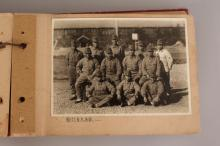 AN INTERESTING EARLY 20TH CENTURY JAPANESE MILITARY SUBJECT PHOTO ALBUM, containing 42 variously sized images, the album itself 8.25in x 5.7in.