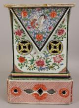 A RARE & LARGE CHINESE YONGZHENG PERIOD FAMILLE ROSE PORCELAIN TALL RECTANGULAR STAND, circa 1730, the front and sides with raised and moulded panels of phoenix and scroll stemmed peach and flowerheads, above pierced 'cash' and foliate sprays, the pierced foot and reverse painted in iron-red with peony and with formal foliate designs, the base unglazed, 10in x 7.1in at base & 14.8in high.