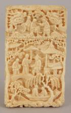 A GOOD QUALITY 19TH CENTURY CHINESE CARVED CANTON IVORY CARD CASE & COVER, decorated overall with scenes of figures in riverside terraces, 3.7in high x 2.25in wide x 0.7in deep.