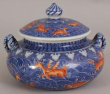 A GOOD QUALITY CHINESE MING STYLE IRON RED & UNDERGLAZE-BLUE MYTHICAL BEASTS JAR & COVER, each piece decorated with a variety of creatures reserved on a ground of overlapping waves, 6.5in wide at widest point & 5.1in high overall.
