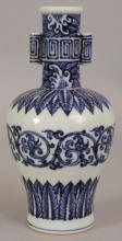 A CHINESE MING STYLE BLUE & WHITE PORCELAIN ARROW VASE, the sides decorated with formal foliate borders and designs, the neck with waves and key-fret, the base with a six-character Xuande mark, 7.7in high.
