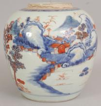 AN EARLY 18TH CENTURY CHINESE KANGXI PERIOD CHINESE IMARI PORCELAIN JAR, the sides of the ovoid body painted with a continuous mountainous river landscape setting, 8.5in wide at widest point & 8.8in high.
