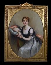 """Jules Cayron (1868-1940) French. An Elegant Lady, Seated in an Interior, Wearing a White and Black Chiffon Dress, Oil on Canvas, Signed and Dated 1908, Painted Oval, in a Fine Gilt Composition Frame, 53.5"""" x 38.5""""."""