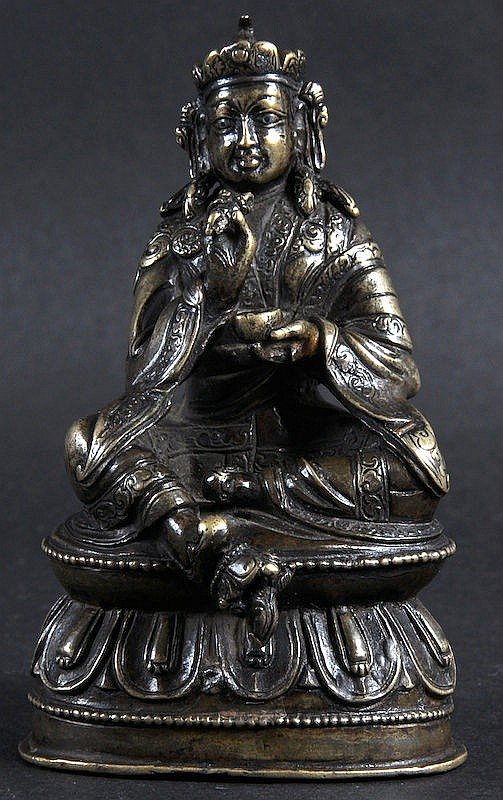A 19TH CENTURY SINO NEPALESE BRONZE FIGURE OF A