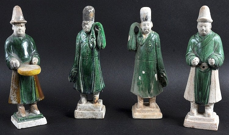A SET OF FOUR 19TH CENTURY CHINESE POTTERY FIGURES