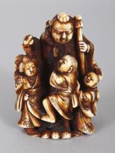 A GOOD QUALITY SIGNED JAPANESE MEIJI PERIOD STAINED IVORY NETSUKE, carved in the form of a standing man in the company of a bijin and four children, the base with an engraved signature, 1.9in high.