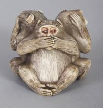 A GOOD QUALITY SIGNED JAPANESE MEIJI PERIOD IVORY OKIMONO OF THE THREE WISE MONKEYS, each with naturalistically engraved and stained fur, the base with an engraved signature, 1.3in high.