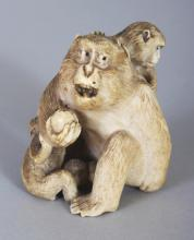 A GOOD JAPANESE MEIJI PERIOD IVORY OKIMONO OF A MONKEY & ITS YOUNG, the fur naturalistically engraved, 1.8in wide at widest point & 2.25in high.