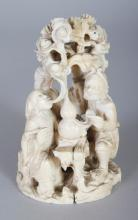 A JAPANESE MEIJI PERIOD IVORY OKIMONO OF THREE DEITIES AND A BOY ATTENDANT IN A PINE GROVE, 3.6in high.