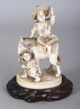 A GOOD QUALITY SIGNED JAPANESE MEIJI PERIOD IVORY OKIMONO OF A FARMER SEATED ON A HORSE, together with a fitted wood stand, the base with an engraved signature on a red lacquer reserve, 5.25in high overall, the ivory itself 4.5in high.