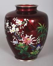A GOOD QUALITY EARLY 20TH CENTURY JAPANESE RED GROUND CLOISONNE & GIN BARI VASE, with chrome rims, 7.25in high.
