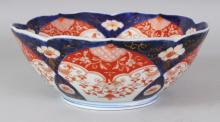 AN EARLY 20TH CENTURY JAPANESE FUKAGAWA IMARI BARBED PORCELAIN BOWL, the base with an orchid mark, 9.25in diameter & 3.7in high.