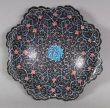 AN INDO-PERSIAN ENAMELLED METAL OCTOFOIL DISH, with a petal-form rim, 6.5in wide.
