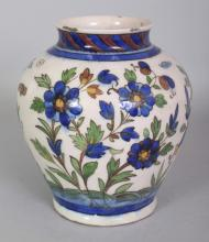 A PERSIAN ISNIK STYLE CERAMIC VASE, the base unglazed, 7.1in high.