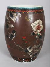 A JAPANESE TOTAI CLOISONNE ON PORCELAIN BARREL FORM JAR, circa 1900, the sides decorated with birds, butterflies and foliage reserved on a brown ground, 8.5in high.