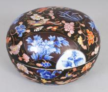 AN EARLY 20TH CENTURY JAPANESE FUKAGAWA IMARI DOMED CIRCULAR PORCELAIN BOX & COVER, the base with an orchid and a maker's mark in iron-red, 5.8in diameter & 4.2in high overall.