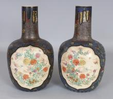 A PAIR OF EARLY 20TH CENTURY JAPANESE TOTAI CLOISONNE ON EARTHENWARE BOTTLE VASES, each painted with barbed quatrefoil Kyoto style panels of cranes and of foliage, each base with maker's marks, 9.75in high.