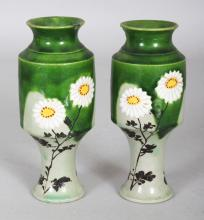 A SMALL PAIR OF EARLY 20TH CENTURY JAPANESE TAIZAN STYLE FLORAL DECORATED GREEN GLAZED EARTHENWARE VASES, 4.8in high.
