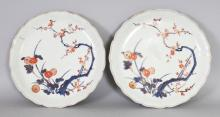 A PAIR OF 18TH CENTURY JAPANESE IMARI PORCELAIN DISHES, with petal-lobed rims, each painted with chrysanthemum and plum blossom, each base with spur marks, 8.25in diameter.