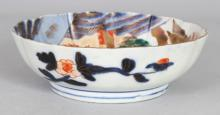 A SMALL EARLY 20TH CENTURY JAPANESE IMARI PORCELAIN LANDSCAPE BOWL, 6.1in diameter & 1.9in high.