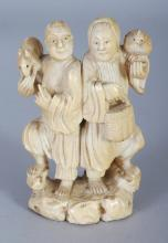 A JAPANESE MEIJI PERIOD IVORY OKIMONO OF TWO STANDING MEN, one bearing a rat on his shoulder, the other a bird, 3.9in high.