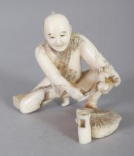 A SIGNED JAPANESE MEIJI PERIOD IVORY OKIMONO OF A GARDENER, the kneeling man leaning forward to trim some flowers, the base with an engraved signature on a red lacquer reserve, 2.5in wide & 2in high.