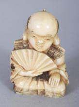A SMALL JAPANESE MEIJI PERIOD IVORY OKIMONO OF A KNEELING MAN, holding a fan, 1.75in high.