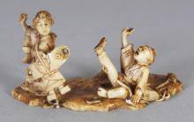 AN UNUSUAL SIGNED JAPANESE MEIJI PERIOD IVORY NETSUKE OF A LADY BEARING A KITE, her son in an animated posture on the ground nearby, the base with an engraved signature on a stained ivory reserve, 1.9in wide & 1in high.
