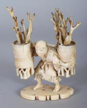 A SIGNED JAPANESE MEIJI PERIOD IVORY OKIMONO OF A FAGGOT GATHERER, bearing two baskets, the base with an engraved signature on a mother-of-pearl reserve, 2.7in wide & 3.5in high.