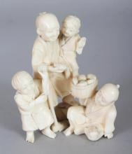 A JAPANESE MEIJI PERIOD IVORY OKIMONO OF TWO FARMERS & THEIR SONS, 2.9in wide & 3.6in high.