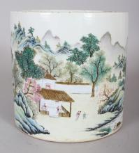 A GOOD QUALITY CHINESE FAMILLE ROSE RIVER LANDSCAPE PORCELAIN BRUSHPOT, the base with a Daoguang seal mark, 5.5in diameter at rim & also 5.5in high.