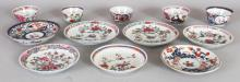 A MIXED GROUP OF TWELVE 18TH CENTURY CHINESE FAMILLE ROSE & JAPANESE IMARI PORCELAIN SAUCERS & TEABOWLS. (12)