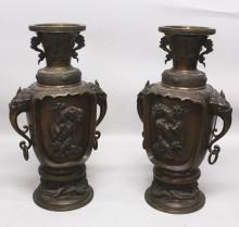 A LARGE PAIR OF GOOD QUALITY JAPANESE MEIJI PERIOD BRONZE VASES, each with a maker's seal mark to its side, 27.25in high.