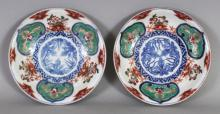 A PAIR OF JAPANESE MEIJI PERIOD IMARI PORCELAIN DISHES, each base with a Fuku mark, 5.8in diameter.