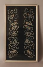 AN UNUSUAL 19TH CENTURY FRAMED CHINESE PAIR OF EMBROIDERED SILK SLEEVE PANELS, framed in a single frame, decorated in seed stitch with ribboned Buddhist emblems, the frame 15.1in x 8.6in.
