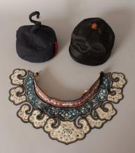 A 19TH/20TH CENTURY CHINESE EMBROIDERED SILK COLLAR, decorated in satin stitch with butterflies and floral sprays; together with a black silk Mandarin hat; and a smaller fabric example. (3)