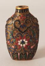 A GOOD QUALITY CHINESE CLOISONNE SNUFF BOTTLE, decorated with formal scrolling lotus, 2.25in high.