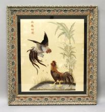 A LARGE 20TH CENTURY FRAMED CHINESE OR VIETNAMESE EMBROIDERY ON SILK, decorated with calligraphy and with a pair of fighting cockerels, the frame 35in wide x 39in high.