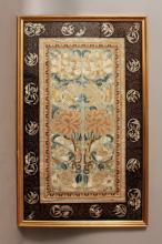A PAIR OF 19TH/20TH CENTURY FRAMED CHINESE EMBROIDERED SILK SLEEVE PANELS, decorated in satin and seed stitch with peony, lotus, butterflies and endless knots, the frame 23.3in x 14.3in.