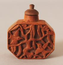 A CARVED WOOD SNUFF BOTTLE & STOPPER, of chamfered rectangular form, 2in wide & 2.3in high overall.