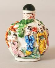 A CHINESE FAMILLE ROSE PORCELAIN SNUFF BOTTLE & GLASS STOPPER, moulded in relief with the Eight Immortals, the base with a four-character Qianlong mark, 2.3in high.