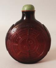 A LARGE CHINESE AMBER GLASS SNUFF BOTTLE & SHAGREEN STYLE STOPPER, the sides decorated with the yin-yang within the Eight Trigrams, 4.25in wide at widest point & 5.3in high overall.