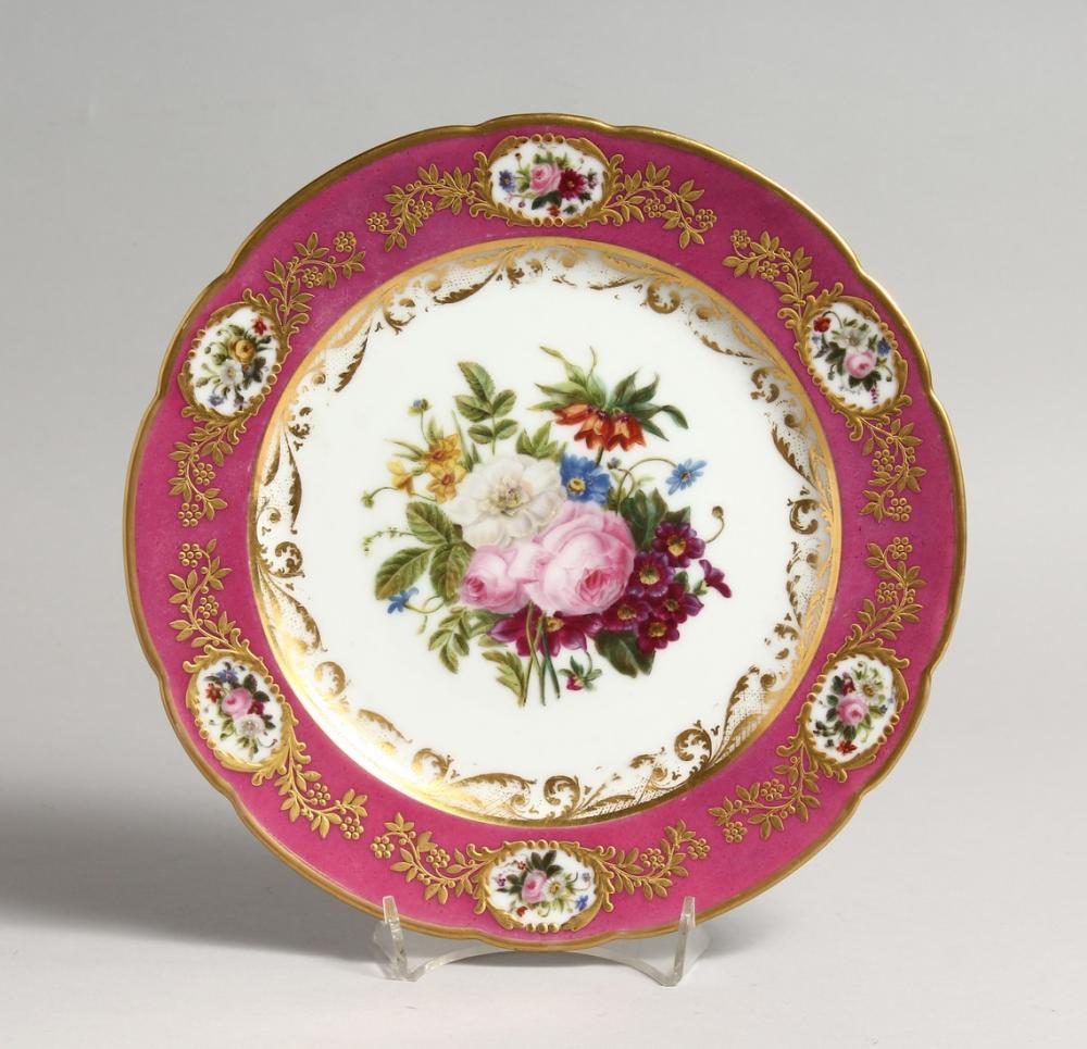 A 19TH CENTURY FRENCH DENVELLE PORCELAIN PLATE with rose coloured border, vignettes of flowers, gilt decorati