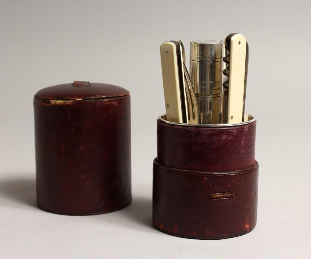A JOSEPH ROGERS TRAVELLING CUTLERY SET in a leather case 6ins high.