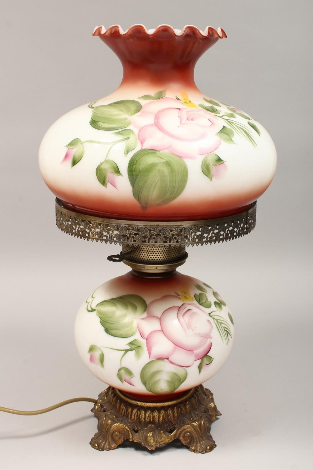 A VICTORIAN OPALINE AND METAL OIL LAMP AND STAND converted to electricity and painted with flowers. 22 ins