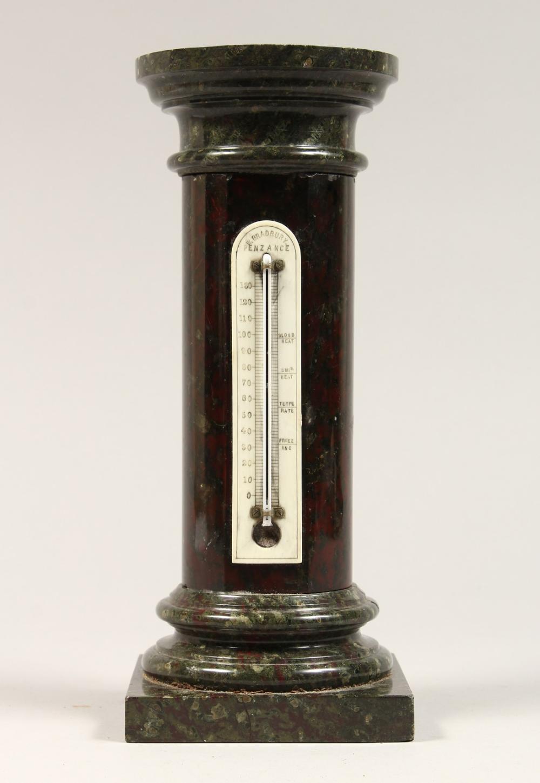 A SERPENTINE MARBLE THERMOMETER, Bradbury, Penzance 10ins high.